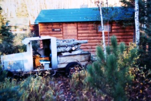 1971, Old Model A Ford loaded with logs outside the new sauna